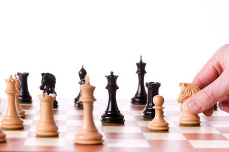 Playing chess game - white knight attacks black queen Stock Photo