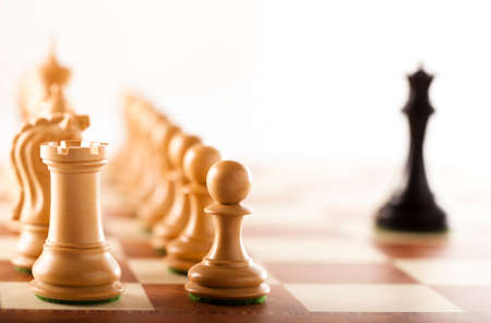 the superiority: Immense superiority - and black chess king against white chess pieces army