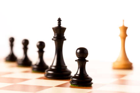 superiority: Immense superiority - white chess king against many black chess pieces Stock Photo