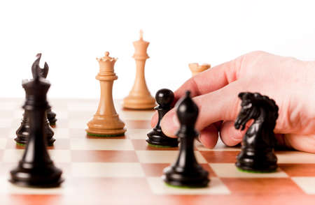 Playing chess game - black pawn captures the white queen