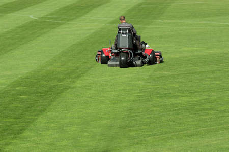 Mowing grass at the football stadium