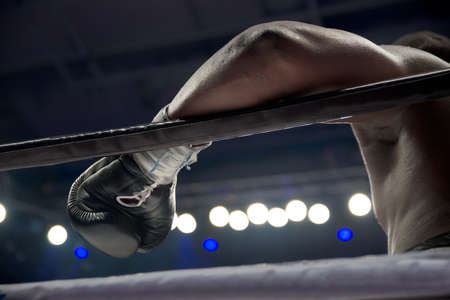 boxer's hand on the ring rope