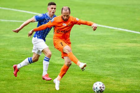 LUBIN, POLAND - JUNE 6, 2020: Match Polish football top league PKO Ekstraklasa between KGHM Zaglebie Lubin vs Lech Poznan 3:3. In action Volodymyr Kostevych (L) and Sasa Zivec (R).