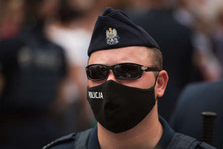 ZLOTORYJA, POLAND - JUNE 12, 2020. Portrait of Policeman during election meeting with President of Poland Andrzej Duda.