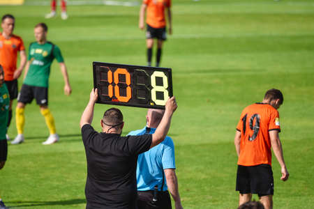 Team manager shows players substitution .