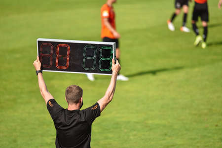 Technical referee shows 3 minutes added time during the football match.