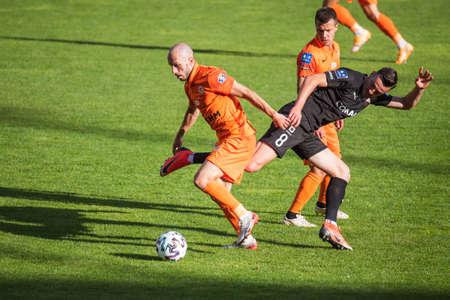 LUBIN, POLAND - SEPTEMBER 20, 2020: Match Polish football top league PKO Ekstraklasa between KGHM Zaglebie Lubin vs Cracovia 1: 1. In action Sasa Zivec (L) and Milan Dimun (R).