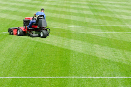 Mowing grass in a football stadium Imagens