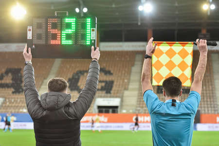 Sideline soccer referee gives signal to substitution Editorial