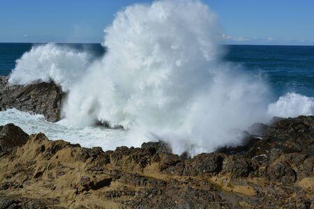 shorelines: wave splash on rock