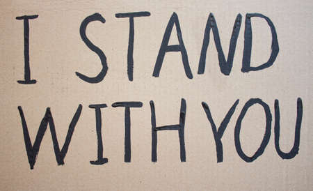 I STAY WITH YOU. Text message for protest on cardboard. Stop racism. Police violence. Banner. Design concept.