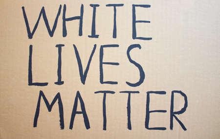 WHITE LIVES MATTER. Text message for protest on cardboard. Stop racism. Police violence. Banner Design concept.