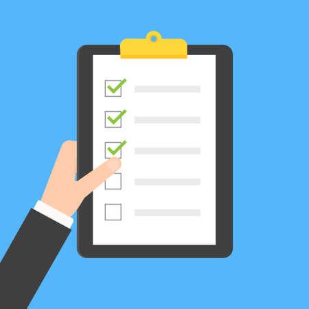 Hand holding clipboard checklist