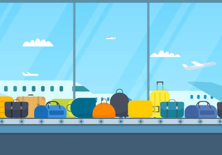Airport conveyor belt with luggage. Planes outside the window