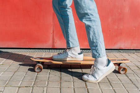 feet with sport shoes on a skateboard in the street Standard-Bild