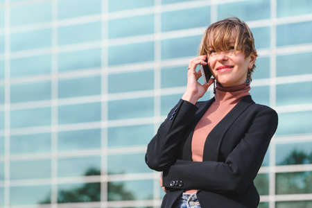 portrait on an attractive blond business woman discussing by phone