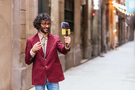 Young caucasian travel video blogger streaming from the streets of Barcelona