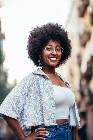 vertical portrait of a beautiful african woman standing on the street Standard-Bild