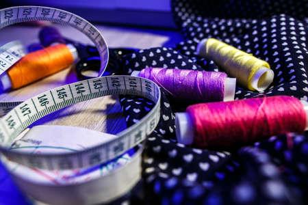 the theme of needlework , sewing, dressmaking, sewing machine