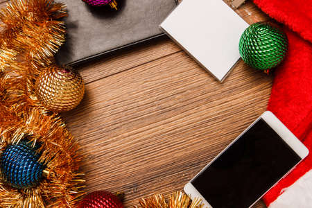 Christmas and new year decorations on wooden background with place for text. Christmas in office, ?hristmas spirit at work. Christmas mood. Stock Photo