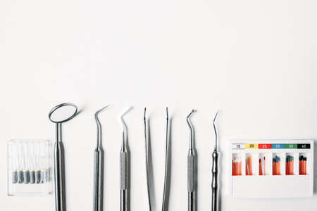 dental and endodontic restoration instruments on a white background. Top view.