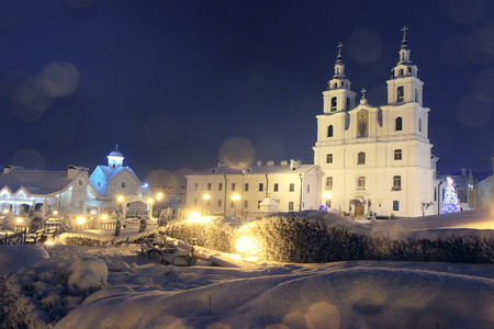 Landscape Church on Christmas night with lamps and sparkling lights. Christmas mood. There comes a new year. Xmas background.