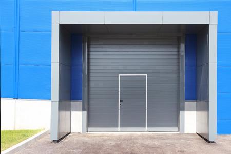 Roller Shutter Door Of Logistic Center For Industrial Background