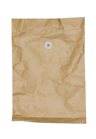 Old brown textured paper envelope isolated on white background. Stock Photo