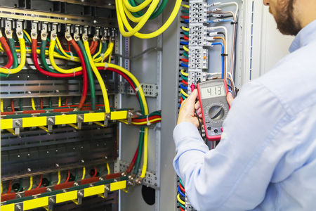 engineer tests power high voltage three phase circuit box with rh 123rf com Service Box Wiring Automotive Fuse Box Wiring