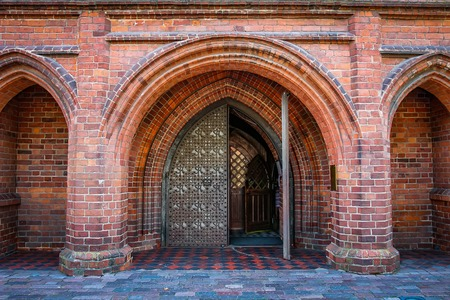 Entrance arch to Catholic Church of Gothic style of red brick. Brick arches in the Catholic cathedral st. Anne in Vilnius, Lithuania.
