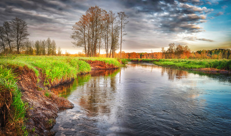 Spring landscape of river in the morning with cloudy sky. Spring wild nature. Scenery view on  beautiful river