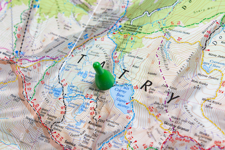 Mountains of the Tatras on a geographical map. Planning a walking route through the mountains