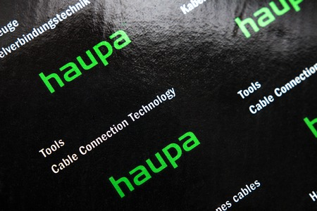 Minsk, Belarus - April 14, 2018: Haupa logo. German company for production of tools for work in wiring and cable. Tools cable connection technology for electric