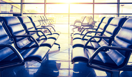 Seats in airport waiting room in sunlight