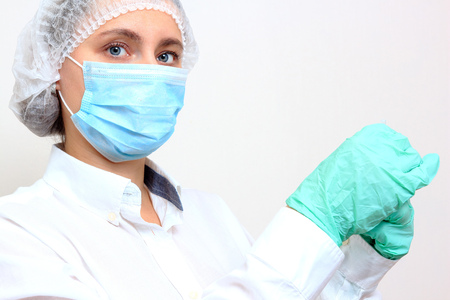 Woman doctor in mask with syringe. Vaccination flu concept