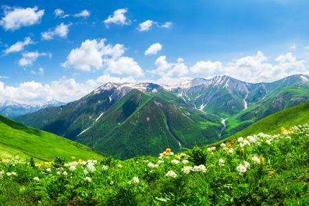 Bright mountain landscape with green valley and blue sky in Georgia. Caucasus highlands