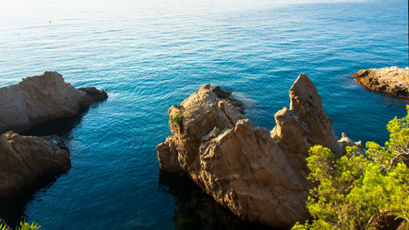 Sea coast landscape with rocky cliffs in water. Sea beach view from above Фото со стока