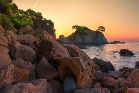 Sunrise in Lloret de Mar coast, Spain. Sea nature landscape in morning sunlight.