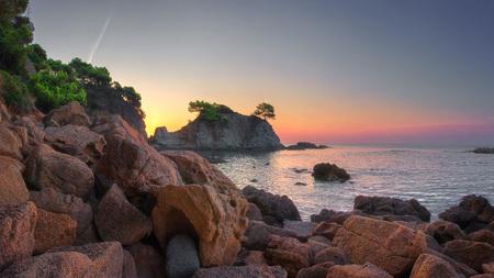 Costa Brava, Spain. Lloret de Mar coast at dawn. Morning seascape of rocky beach