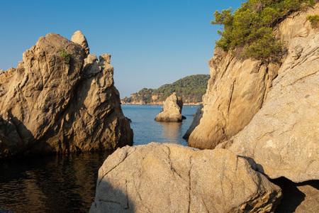 Costa Brava seascape. Spain coast. Rocks and cliffs in sea beach in Lloret de Mar in clear morning
