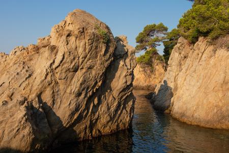 Cliffs in sea on Costa Brava coast, Spain. LLoret de Mar seascape. Sea nature in spanish shore Stok Fotoğraf
