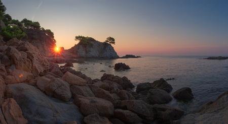 Morning sea nature landscape in Spain. Sunrise in Lloret de Mar coast. Costa Brava beach at dawn. Stok Fotoğraf