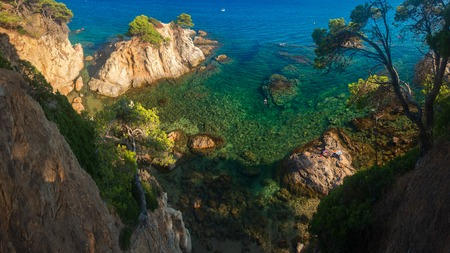 Lloret de Mar sea coast with cliffs in water. Spain blue lagoon in Costa Brava Stok Fotoğraf