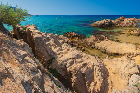 Spain beach. Blue summer sea rocky beach in spanish coast. Resort vacation on sea Costa Brava Stok Fotoğraf