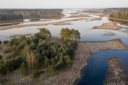 Spring river. Flood on floodplain at springtime. River view from above