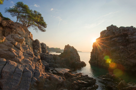 Costa Brava sea landscape on sunset. Morning sun in Lloret de Mar on Santa Cristina beach