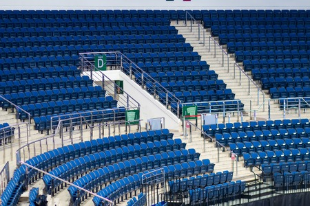 Empty seats on tribune ice arena. seating rows spectator stands for the ice hockey stadium