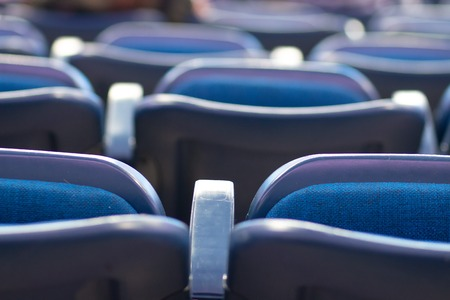 Seats in the cinema. Soft chairs in a row in a modern cinema