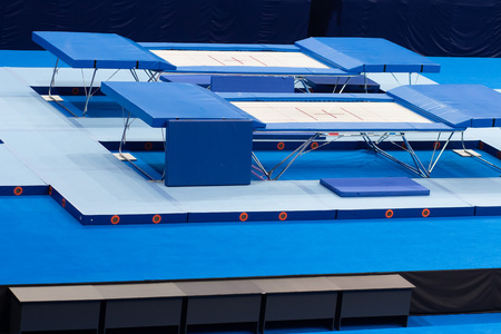 Empty trampolines in the sports arena during sport competitions