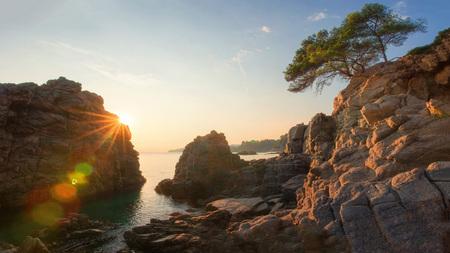 Costa Brava, Spain. Scenic seascape at sunrise. Rocks in sea beach in Lloret de Mar beach.